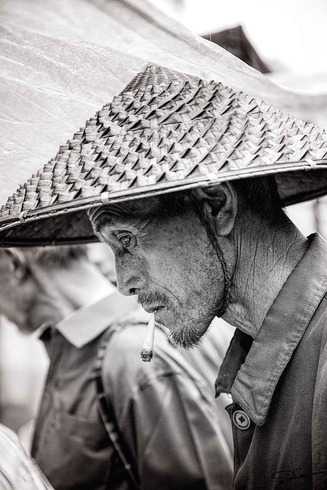 aug2016-rumos-JClayton-farmer-in-hat-market